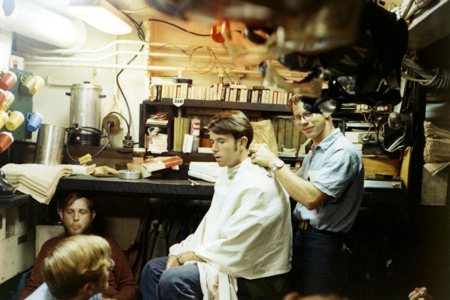 06-higgins-giving-haircut-stan-kramer-far-left-w